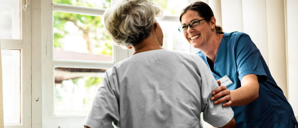Image of a resident and a nurse who has learned about the American Association of Post-Acute Care Nursing (AAPACN)