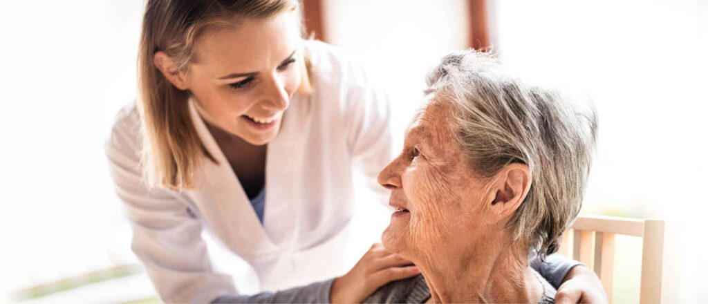 Image of an AAPACN member with an elderly resident